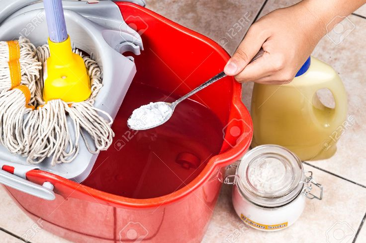 44084291-add-baking-soda-to-floor-cleaner-for-house-cleaning-stock-photo.jpg