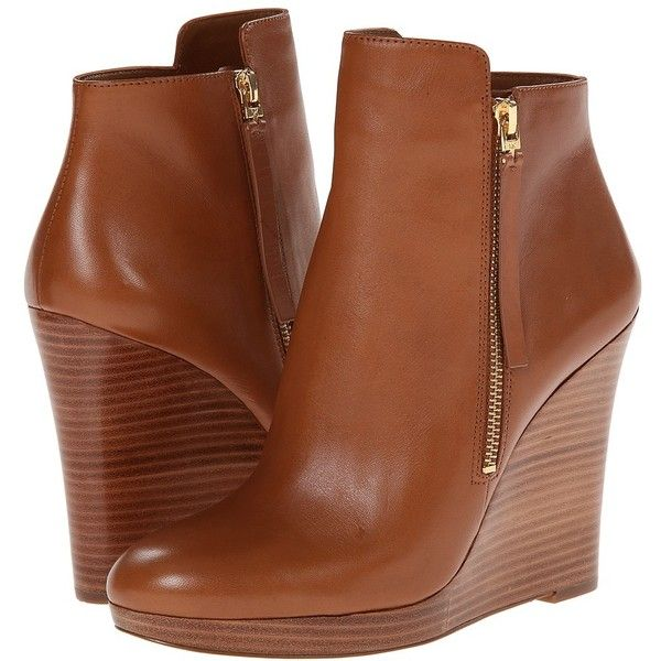 Complete your polished look with these elegant wedge booties. Side-zip closure. Smooth leather upper. Rounded-toe. Leather lining and footbed. Stacked wedge he…
