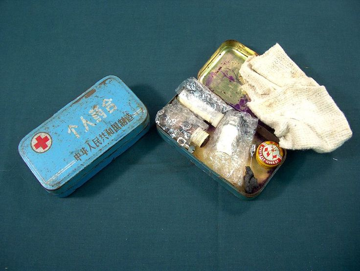 Two captured North Vietnamese Army first aid tins.