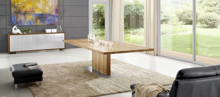 DT7580 Solid American Walnut Timber Dining Table. Timber furniture adds a warm, natural sophistication to the starkness of modern, minimalist design with functionality in mind. Our solid timber is responsibly sourced from American walnut trees and expertly finished with a unique wax oil that brings out the natural colors and grains while protecting the wood from daily use.