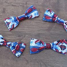 Lot de quatre nœuds  pagne  bleu/noir/blanc/rouge