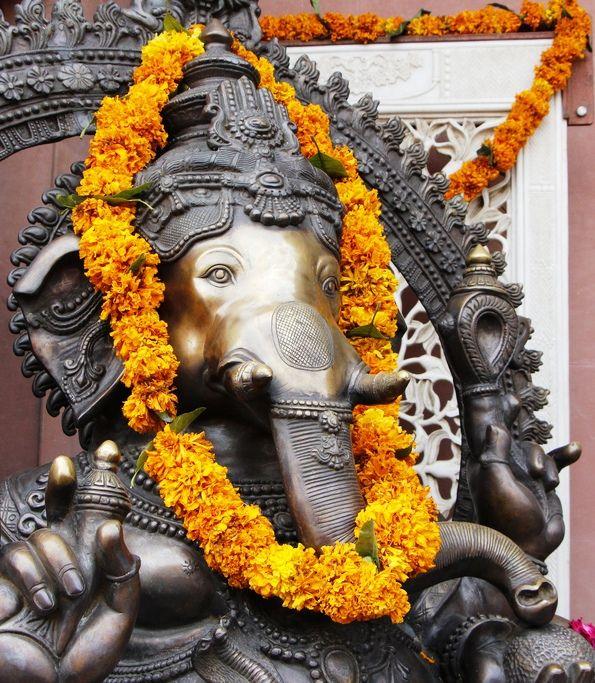 In Mumbai, marigolds decorate the Hindu God, Ganesh, in celebration of Diwali, the Festival of Lights.