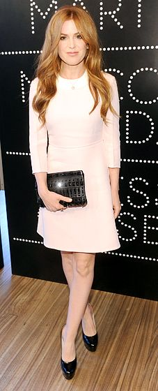 Isla Fisher: Catherine Martin and Miuccia Prada Dress Gatsby Opening Cocktail The actress looked gorgeous in an off-white Prada dress and black pumps at the cocktail party honoring her new movie in NYC on Apr. 30.