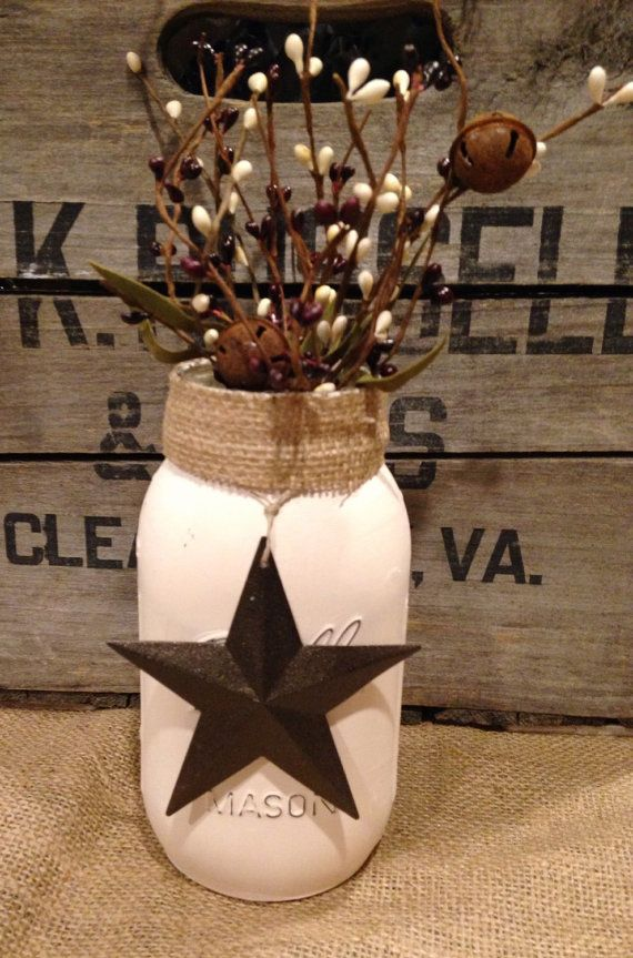 SIZE: QUART ( APPROX. 6.9 TALL). Hand painted cream-colored, distressed mason jar with pip berries, burlap and a brown barn star. Perfect for