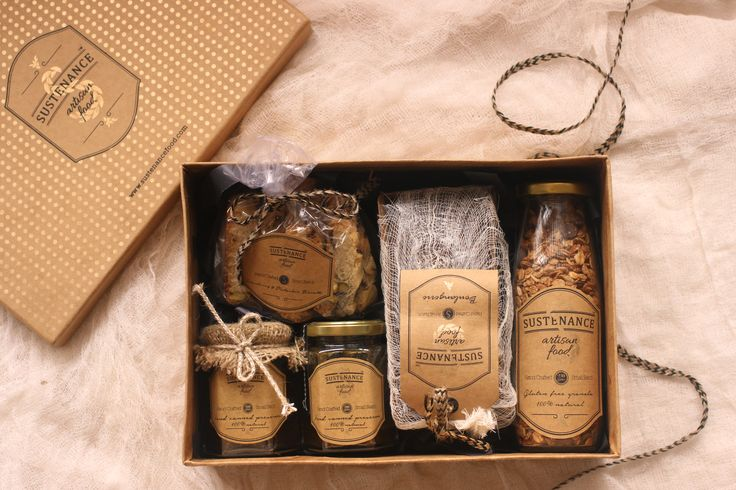 Our lovely hostess box has delicious biscotti, lemon yogurt cake, honey whiskey mustard, spiced plum jam and chocolate hazelnut granola!