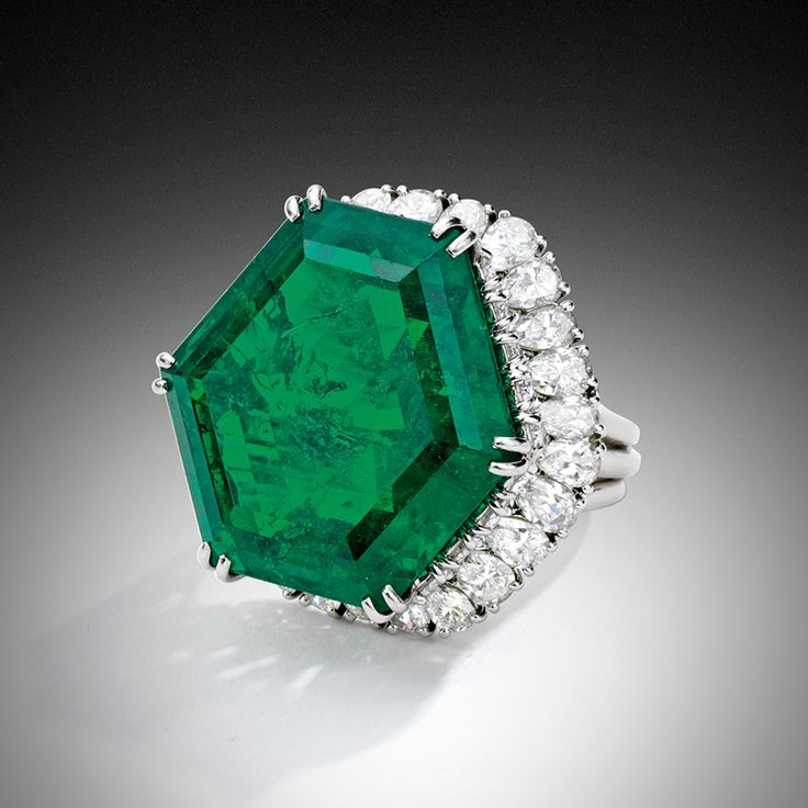The Magnificent and Legendary Stotesbury Emerald Platinum, Classic Colombian Emerald and Diamond Ring, Harry Winston, the emerald weighing approximately 34.40 carats.