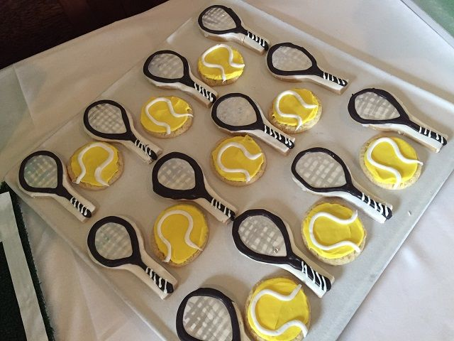 A tennis party with lots of easy DIY tennis elements! Tennis court placemats, Tennis racket cupcake toppers, tennis ball cake pops
