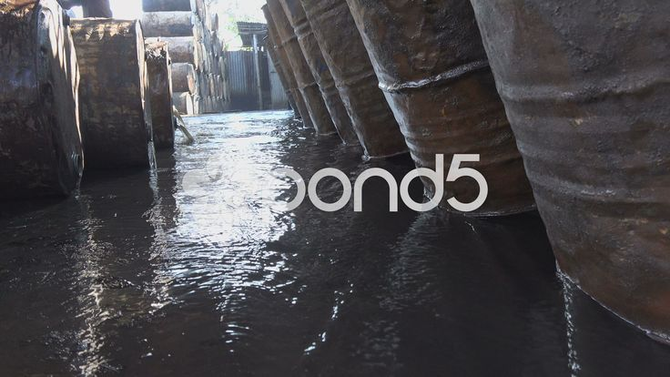 Bangladesh, cleaning oil barrels, waste water, pollution, environment - Stock Footage | by stefhoffer