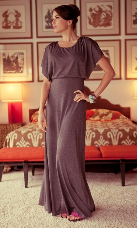 Lounge like a Lady! Made from a lush, soft jersey fabric and completed with a double-layered top and kimono sleeves, this maxi dress is the essence of easy dressing. The charcoal, heather grey color connotes a modern feel. A perfect outfit for lounging at home or a day in the desert.