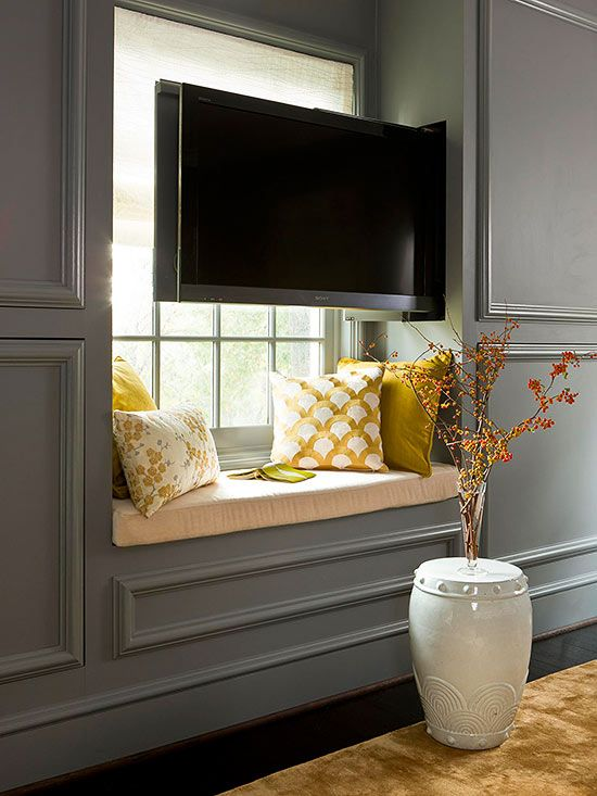 Traditional Appeal Meets Modern Technology In The Master Bedroom Where A Pullout TV Above Window Seat Is Handsomely Concealed Within Paneled