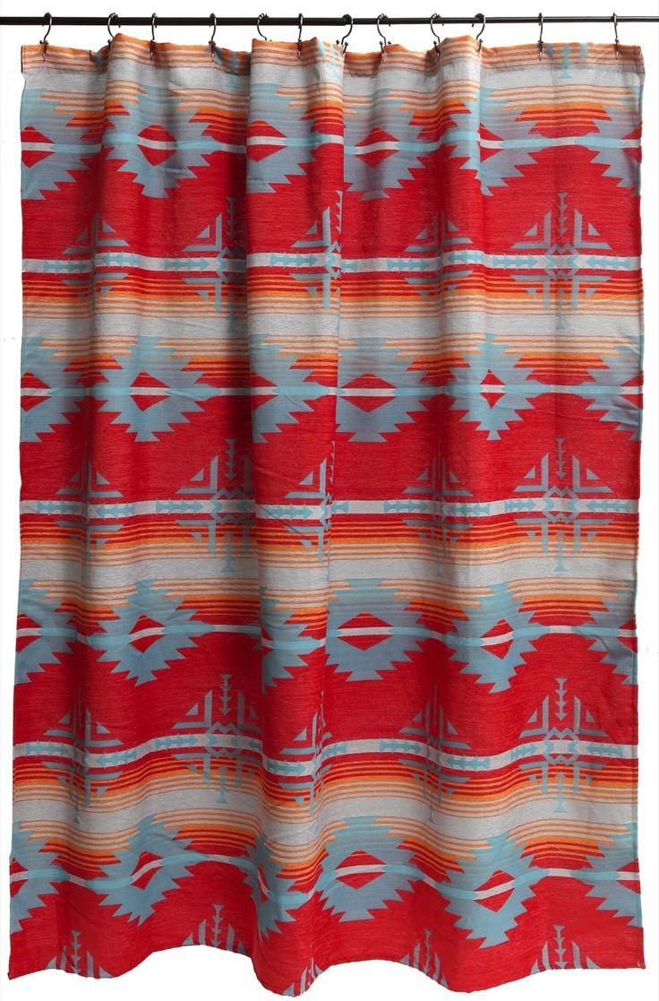 The Southwestern Shower Curtain is brilliantly colored with Aztec diamond designs throughout. Red/coral, turquoise & burn orange coordinate perfectly here.