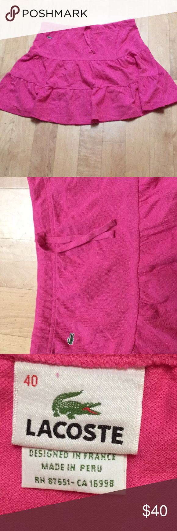 """VERY CUTE Lacoste pink skirt PERFECT CONDITION High end Lacoste brand tiered pink skirt. Has an easy fitting drawstring waist.  Made of 100% cotton (pique texture).  Purchased at Neiman Marcus. Approx 18.5"""" long Lacoste Skirts Mini"""