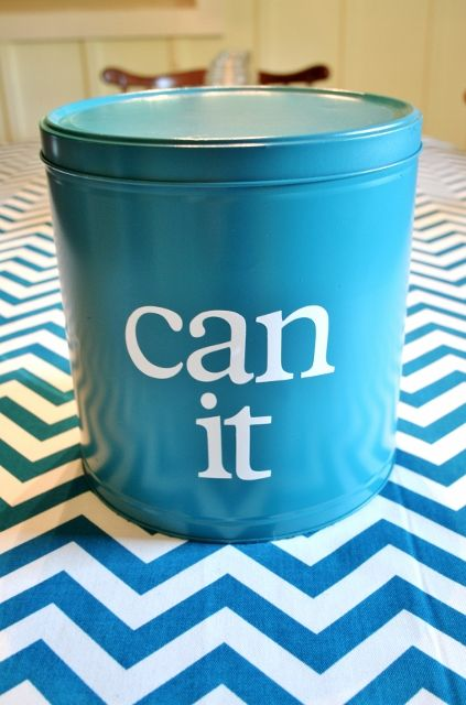 Upcycle a popcorn tin into a great storage container! Just spray paint it and put a cute vinyl saying on it! | www.rappsodyinrooms.com