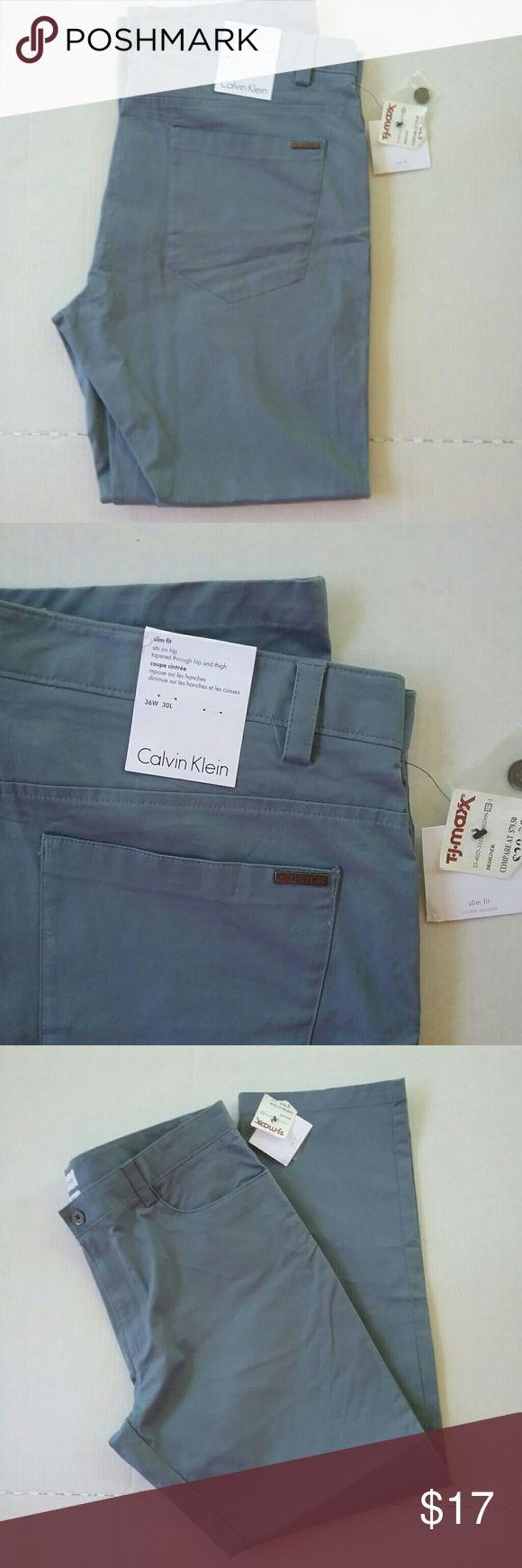 CALVIN Klein Steel Blue Pants Jeans Slim Fit 36X30 This is a pair of men's slim fit Calvin Klein pants. They are   steel blue color. They are size 36 30. They are new with tags. Calvin Klein Pants Chinos & Khakis