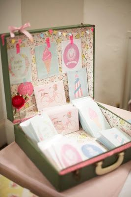 Inside of a suitcase used to display handmade cards at a craft fair.