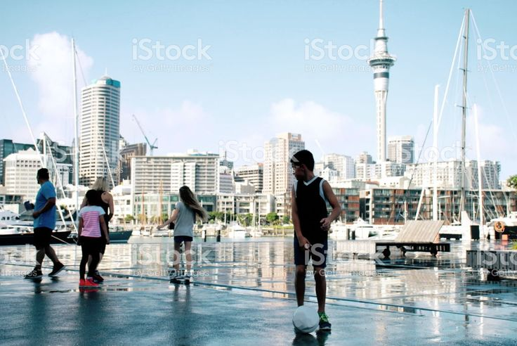Group of Family Friends Play Soccer against a cityscape royalty-free stock photo