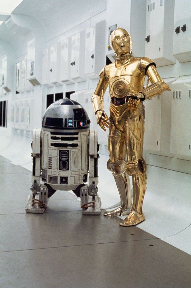 Classic 1977 portrait of C3-PO and R2-D2 on board the Rebel Blockade Runner.