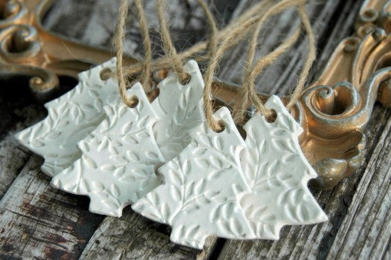 *** Pre-Order *** Ornaments will begin shipping November 15th. Thank you!  Christmas Tree Ornaments . Handmade Clay Ornaments  A sweet set of { 5 } handmade . Christmas Tree ornaments  These ornaments are so much prettier in person, with the rustic look of clean white clay, and a touch of shimmer, for added elegance. They twinkle with the reflections of light, and will make a beautiful addition to your holiday tree. They can also be used as gift tags, to give your packages an added touch…