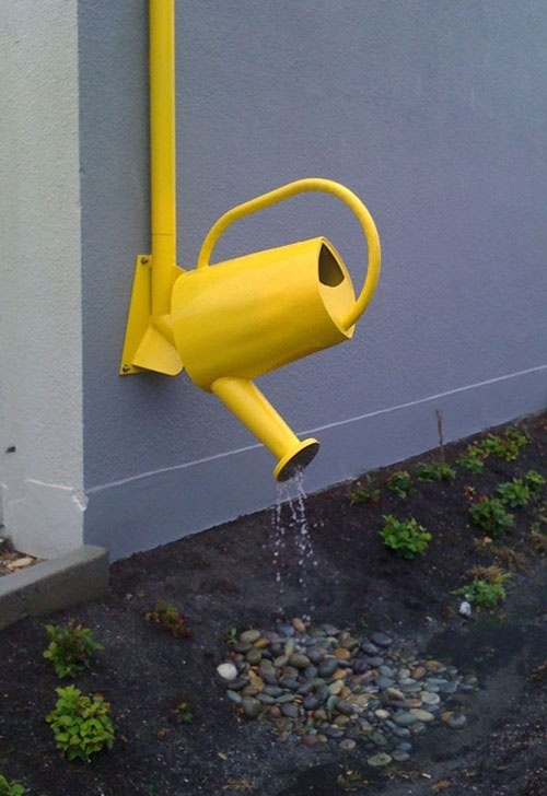 There is no downside to this little yellow downspout! Functional, yet fun.