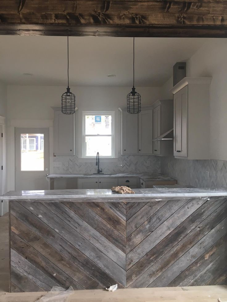 East Nashville rustic modern interior. Marble herringbone backsplash. Chevron barnwood island. Superior Development LLC