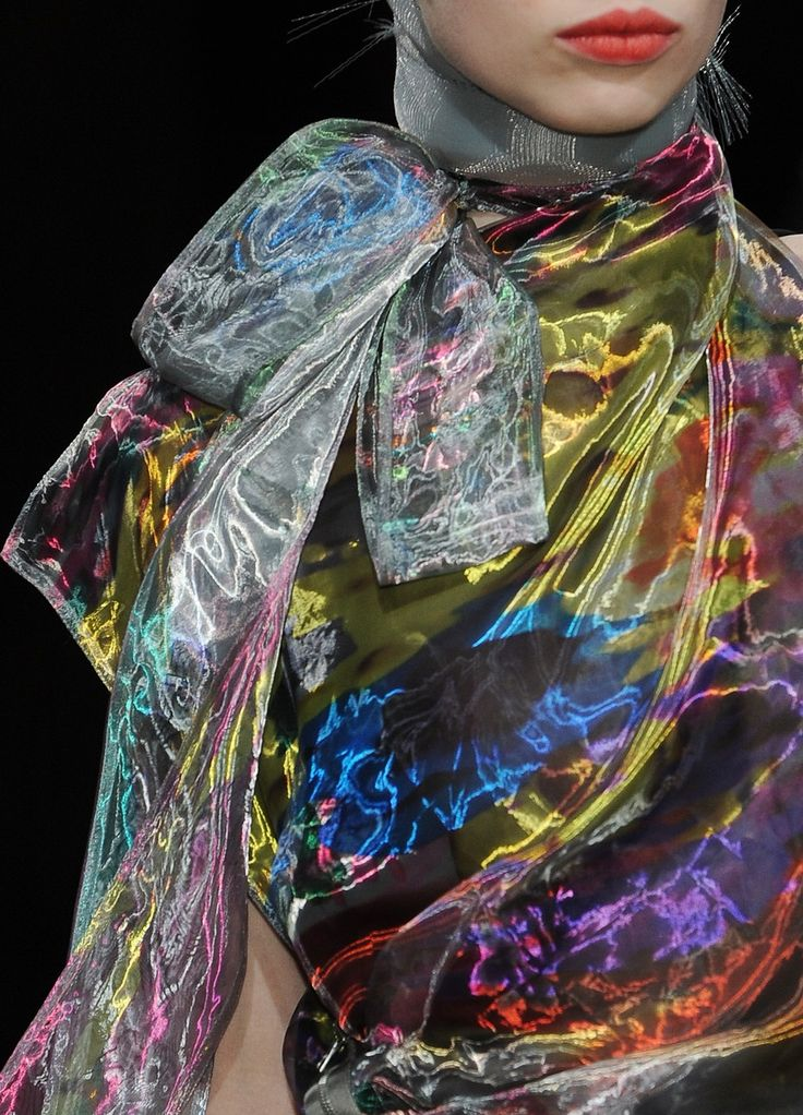 Iridescent blouse. I'd wear it with a strict black wide skirted suit. /Viper Style