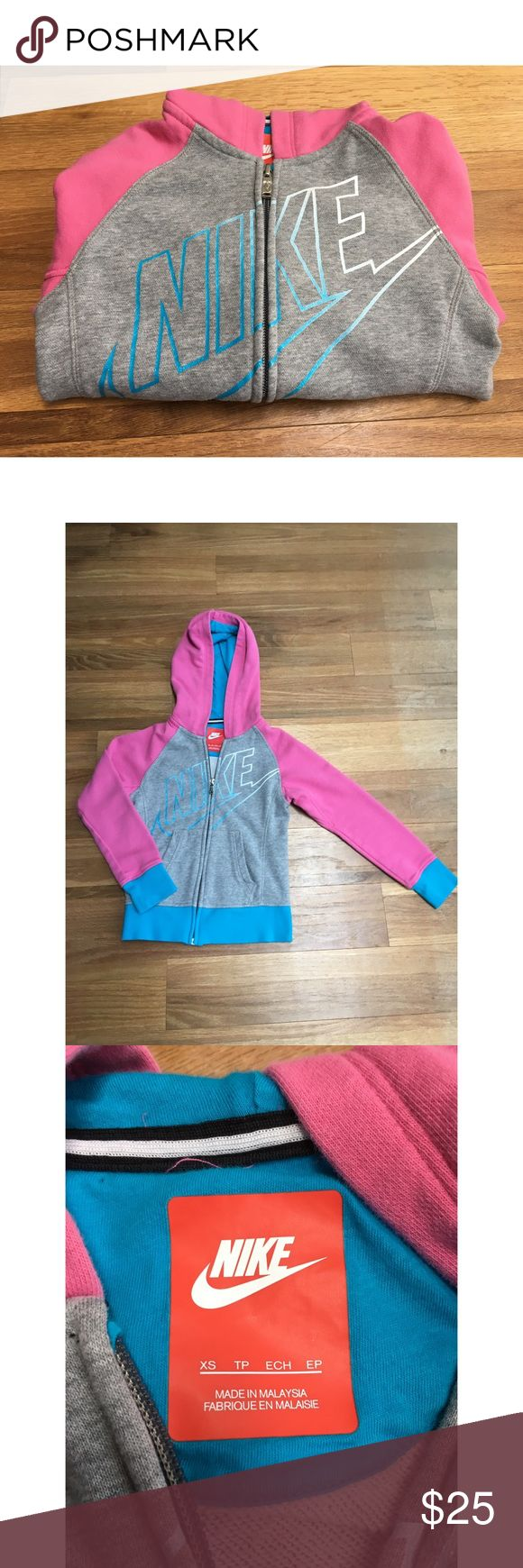 Girls NIKE Pink, Blue ,and Grey Zip Up Hoodie Excellent used condition, not sure if it was ever even worn! From my pet free and smoke free home no trades. Nike Shirts & Tops Sweatshirts & Hoodies