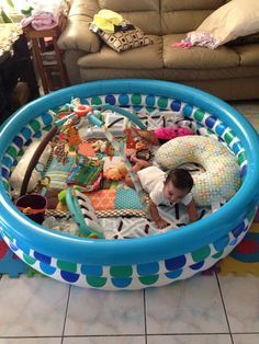 DIY Playpen! Here is a creative waay to secure your babies play area! A kids pool that is 3 ringed and then just put abc play matt underneath.