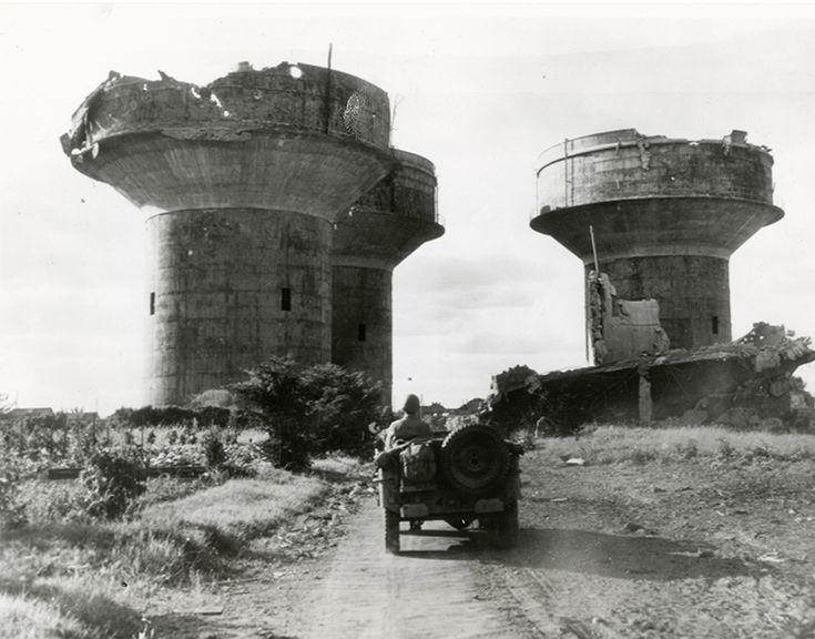 These three enormous flak towers guarded a German Marine base near Angers, France. Each tower would have been armed with several large caliber and small caliber anti-aircraft guns. They were destroyed by Allied air attacks as General Patton's 3rd Army advanced East via reddit