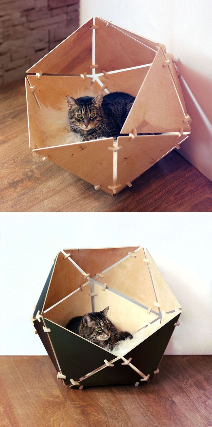11 Cat Caves That Prove Cat Beds Can Be Stylish // Line this wood paneled geometric bed with a cozy blanket or pillow and create a soft, warm spot that your cat will be happy to take cat-nap in.