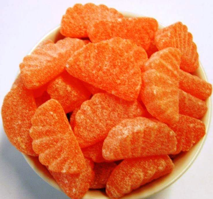 Orange jelly candy---my grandfather kept some in the corner cupboard of the dining room for us grandkids