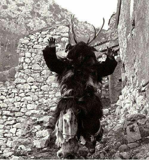 Pastore mascherato con pelli di capra e corna di cervo, per spaventare la malasorte. Mask of Sardinia-