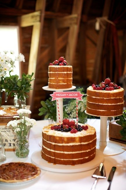 Naked Wedding Cakes~~  How do you guys feel about naked wedding cakes (aka cakes with no outer frosting?)… I find them to be quite beautiful in a rustic yet girlie kind of way…. They do have a sort of rebellious unconventional look to them, which makes me like them more lol {click to read more} #naked #wedding #cake