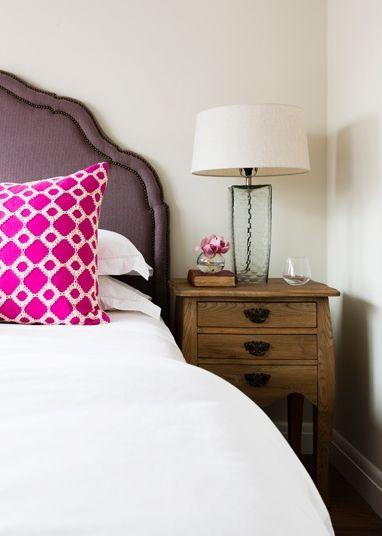 Love this headboard/throw pillow/lamp combo!