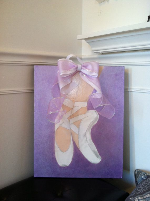Ballerina shoes, sealed acrylic painting topped with a bow. Painting is done on a canvas panel and attached to a wood stained frame. A nice