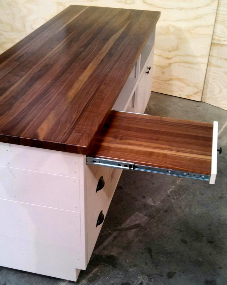 Cash wrap sales counter with pull out shelf cutting board. Very rustic, unique piece! http://jbrothersandcompany.com/