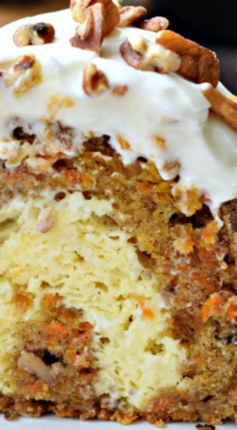 Carrot Bundt Cake ~ With a cheesecake filling and cream cheese frosting... The best dessert ever!