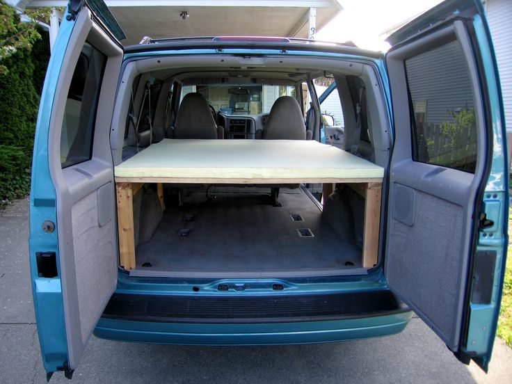 Camperized Astro/Safari - Lots of space underneath with bed posts attached to the walls.  Drawer underneath for the rear of the vehicle, fold up to seats for the front?