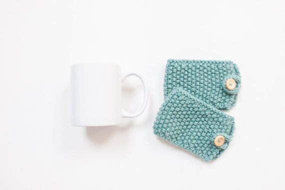 This listing is for a pair of ready to ship, knitted Coffee Mug Cosy / Cup Cozy in Teal. It is the perfect way to enjoy your morning cup of tea or coffee in style. The coffee sleeve has lots of stretch so should fit most mugs, even take away cups. It keeps your beverage nice and warm and your hands cool. Perfect for a teacher gift, secret santa or stocking filler and the rustic pattern is suitable for both men and women.  These mug cosies are also available in a variety of different colo...