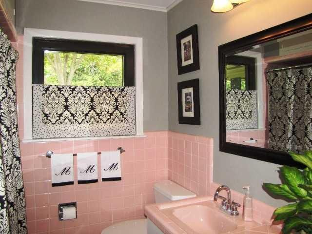 Probably the worst thing to happen to a bathroom...Pink tile except for green or blue  ( Gag ) Amazing how the Black and grey make it tolerable. Amazing what a little design can do.