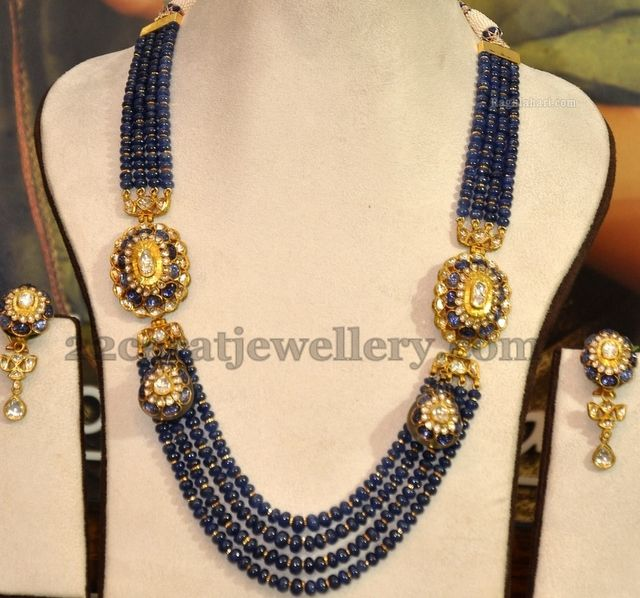 Small blue sapphire beads and gold small bits combination four strings intricate beads long chain with yellow gold metal used kundan desi...