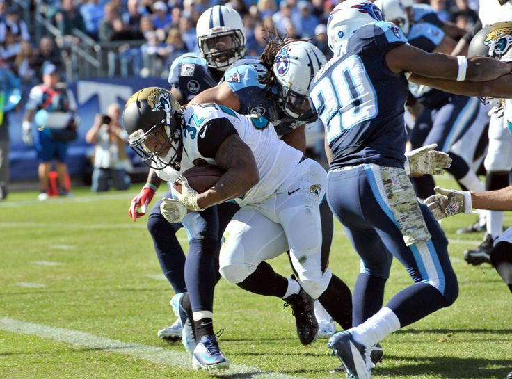 Best of NFL Week 10 - NFL: Jacksonville Jaguars at Tennessee Titans -- Nov 10, 2013; Nashville, TN, USA; Jacksonville Jaguars running back Maurice Jones-Drew (32) scores a touchdown against Tennessee Titans strong safety Daimion Stafford (39) during the first half at LP Field. (Jim Brown-USA TODAY Sports)