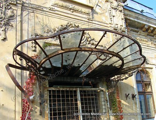 1900s glass architecture | Bucharest 1900s architectural ironwork: clam shell awning structure ...