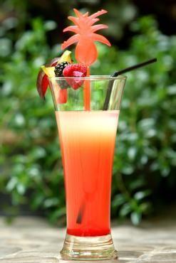Zobacz zdjęcie PARADISE - DRINK BEZALKOHOLOWY     Składniki:  * syrop z grenadiny,   * syrop amaretto   * sok pomarańczowy   * sok grapefruitowy   * sok cytrynowy w pełnej rozdzielczości