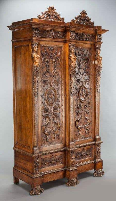 A TUSCAN CARVED WALNUT ARMOIRE 19th century 95-1/2 x 55 x 22 inches (242.6 x 139.7 x 55.9 cm)