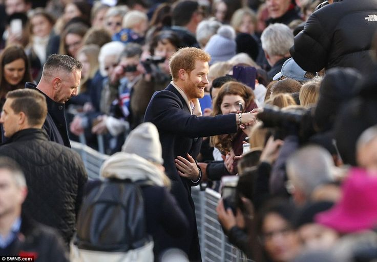 Harry talks to members of the public in Nottingham city centre during their first official royal outing this morning