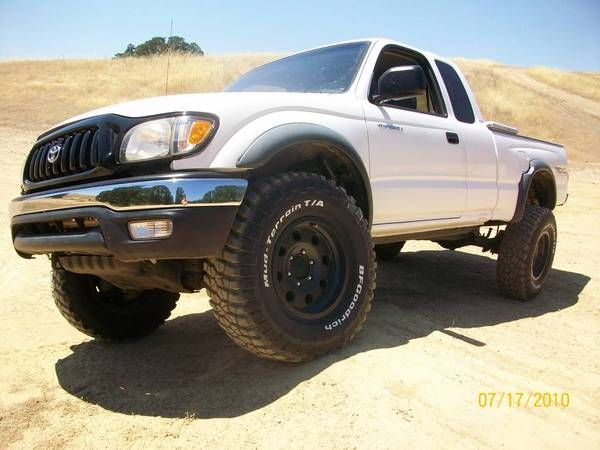 """2001 TACOMA - EXTCAB - 3.4L - 5SPD - 4X4 - TRD - ATX MOJAVE 16X8 - BFGOODRICH KM2 285/75/16 - 3.5 FAB TECH COILOVER - WHEELERS ALCAN 5PACK LEAF SPRINGS - DAYSTAR 1.25 SHACKLE LIFT - REAR 10"""" 5125 BILSTEIN - GOODRIDGE STEEL LINES - GRAY WIRE MOD - K&N CAI - OPTIMA RED TOP - MAGNA FLOW EXHAUST - BPV BRACKET - DIFF DROP - GRILL PAINTED BLACK - LOW PRO TOOL BOX - BLACK BED EXTENDER - HUSKY LINERS - STREAMLIGHT STINGER MOUNTED WITH LED UPGRADE"""