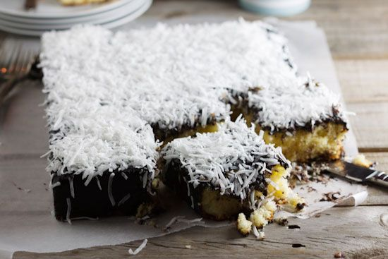 Light and fluffy vanilla cake covered with a delicious chocolate icing and topped with a generous amount of shredded coconut, this Lamington slice is perfect with coffee!