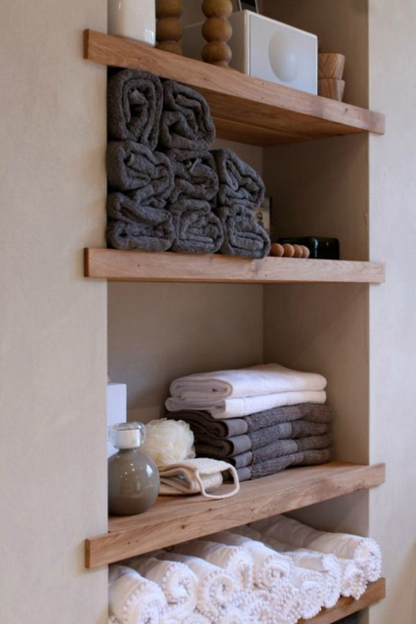 Basement bathroom storage. Love the recessed space and wooden shelves.