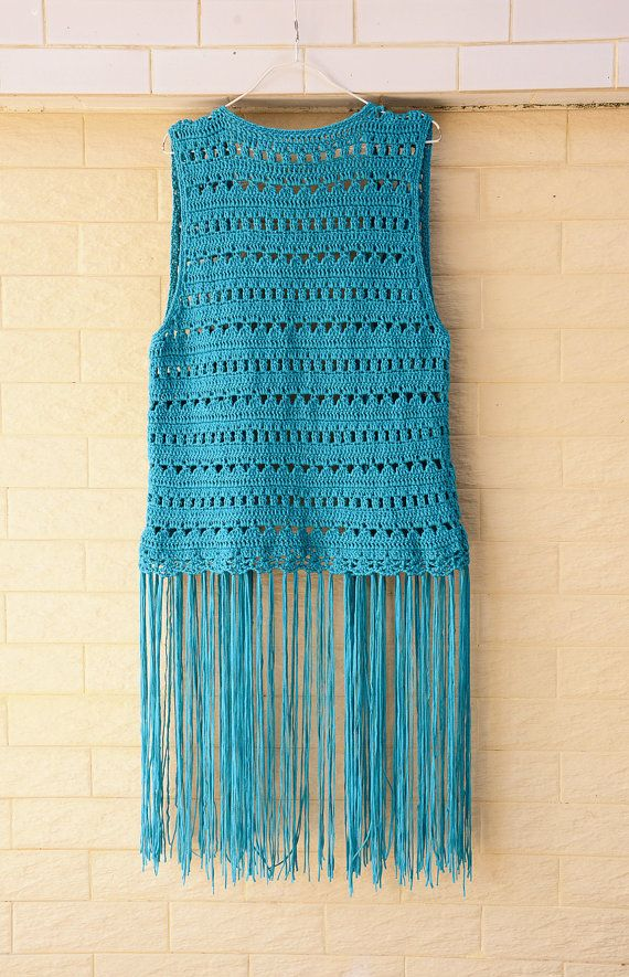 This cute fringed crochet long vest is handmade by over 30 years experienced craft artist with care and love in every stitch. Please feel free to let me know if you need a different color or size.  Perfect to creat a hippie boho chic look in music festival or as beach cover up with your favorite crochet bikini set  Measurement: Bust: 35-38 Length: 25 and 35with tassels  Crocheted in easy care acrylic yarn, machine wash cool, gentle cycle, and short machine dry, low heat, or roll in a towel…