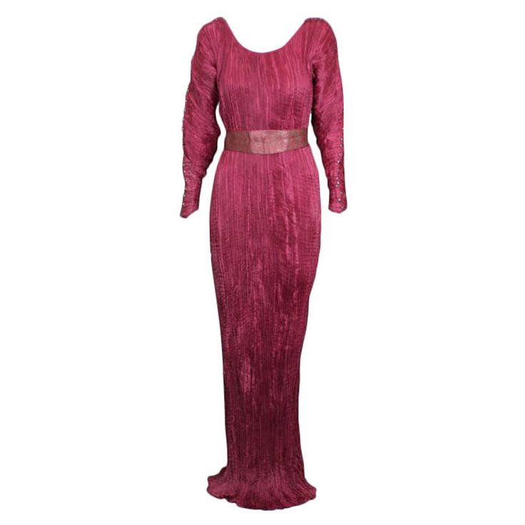 Rare Mariano Fortuny Deep Begonia Long Sleeved Delphos Gown This dress is made of finely pleated dark begonia colored silk with silk cording along side seams, and multicolored glass beads threaded through the cording.